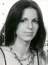 Portraitfoto aus dem Diplomatenpass von Petra Erler, 1990.